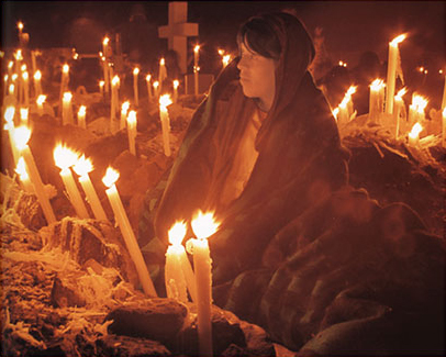 Woman with a somber gaze in the cemetery vigil
