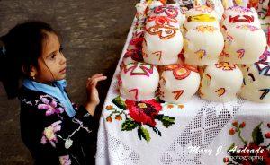 A girl admires the sugar skulls, Patzcuaro, Michoacan.