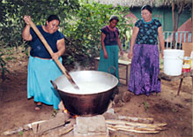 Ladies cooking traditional Day of the Dead meals